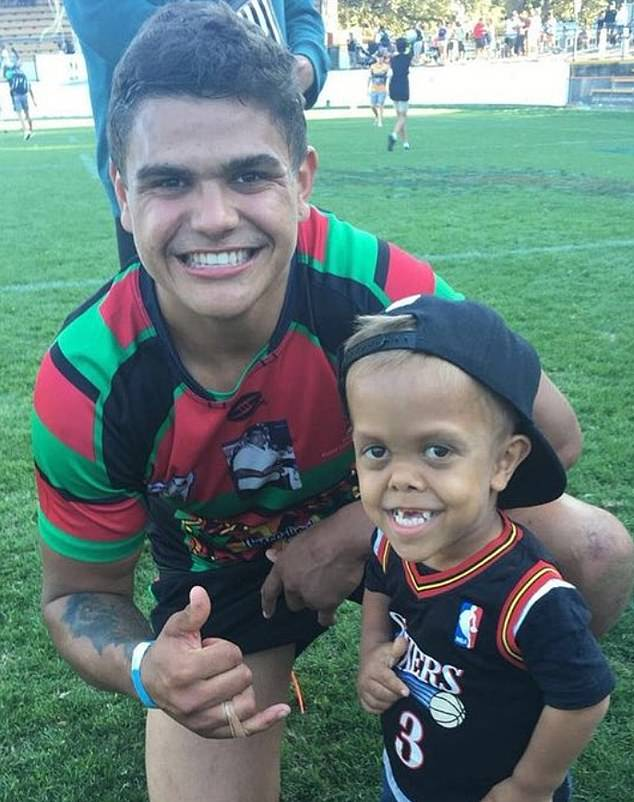 Quaden is pictured with NRL star Latrell Mitchell. The nine-year-old was invited to lead the Indigenous All-Stars NRL team onto the pitch on Saturday