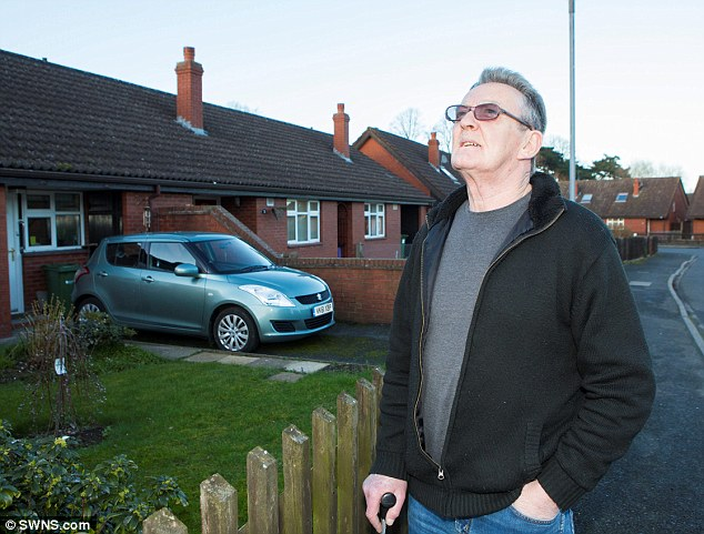 Stephen Payne, resident of Macmillen Close, Hereford, looks up at the sky where thousands of starlings appear every night